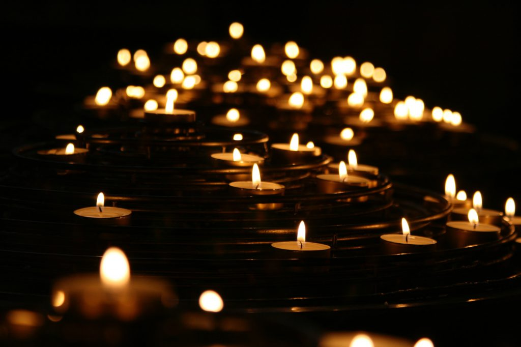 decorative image: candles on dark water