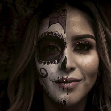 decorative image: woman with face paint for the day of the dead
