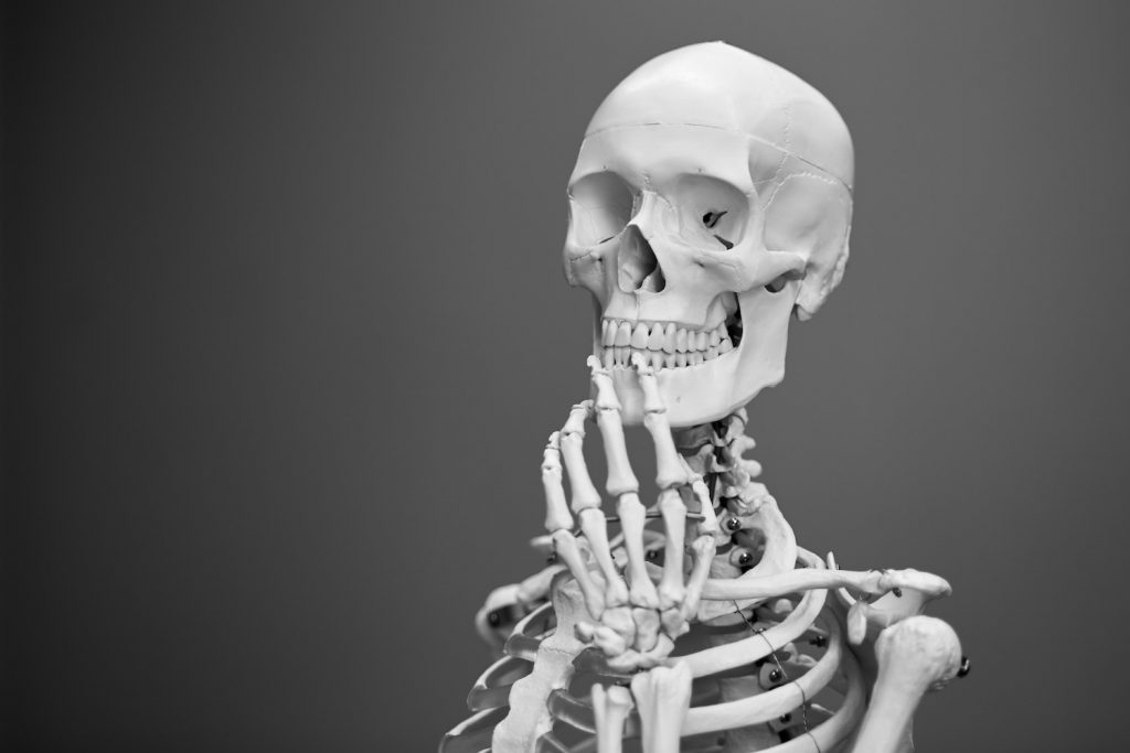 deco image: skeleton in thinking pose