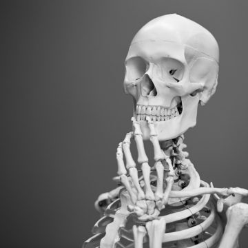 deco image: skeleton in thinking pose