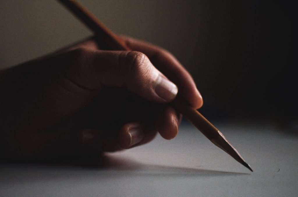 deco image: pencil in hand
