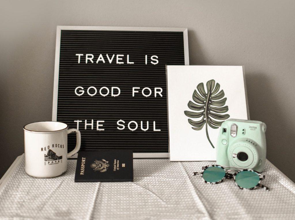 decorative image: teal Instax Mini 8 instant camera near decor