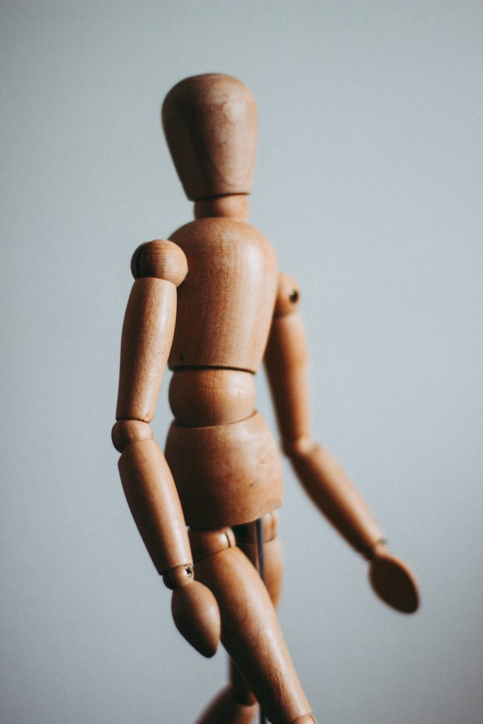 decorative image: wooden doll