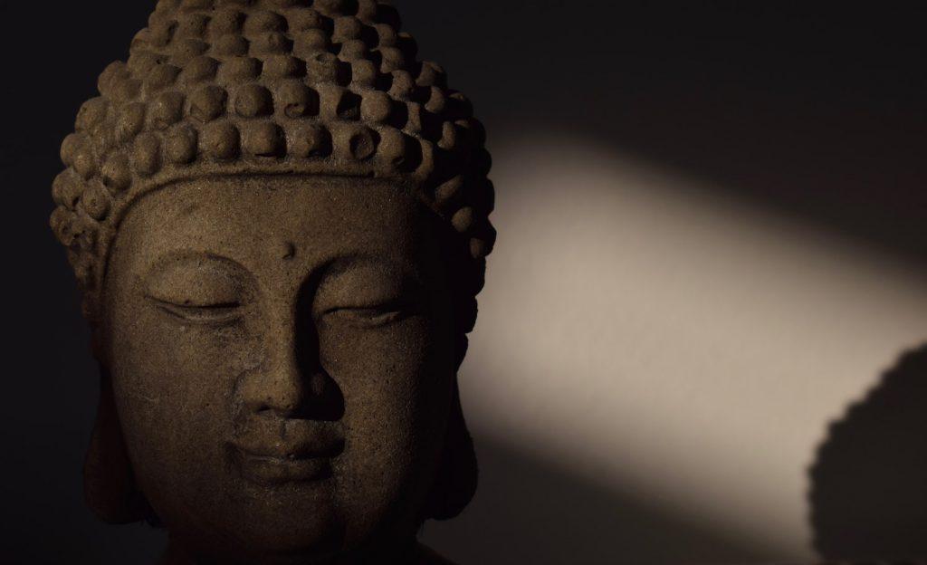decorative image: Buddha head statue