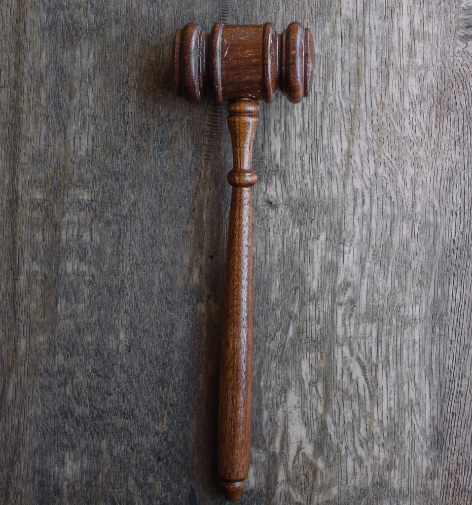 decorative image: brown mallet on gray wooden surface