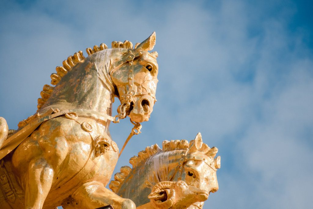 decorative image: golden horses